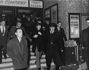 The Beatles leaving The Ritz hotel.
