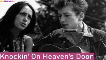Bob Dylan playing guitar and harmonica.