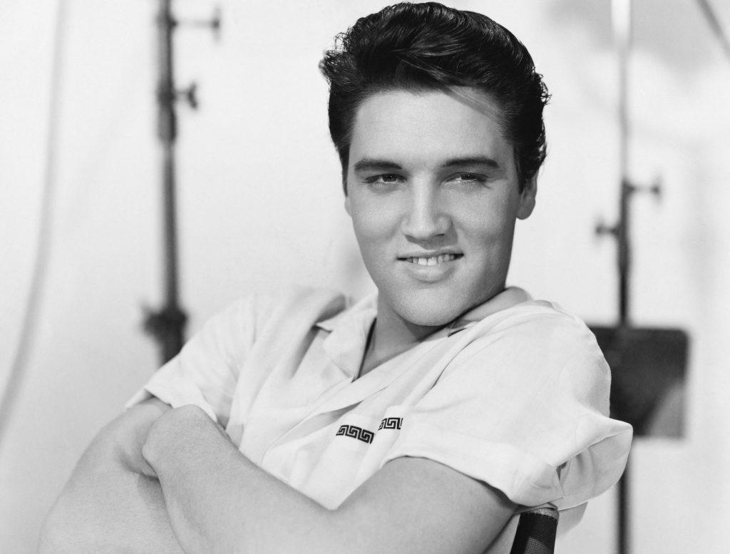 Elvis Presley grinning in 1958.