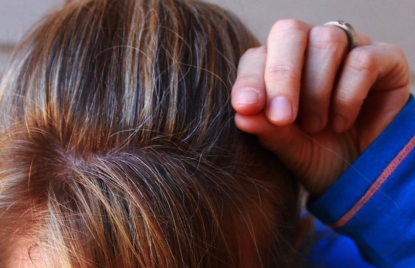 woman plucking gray hair