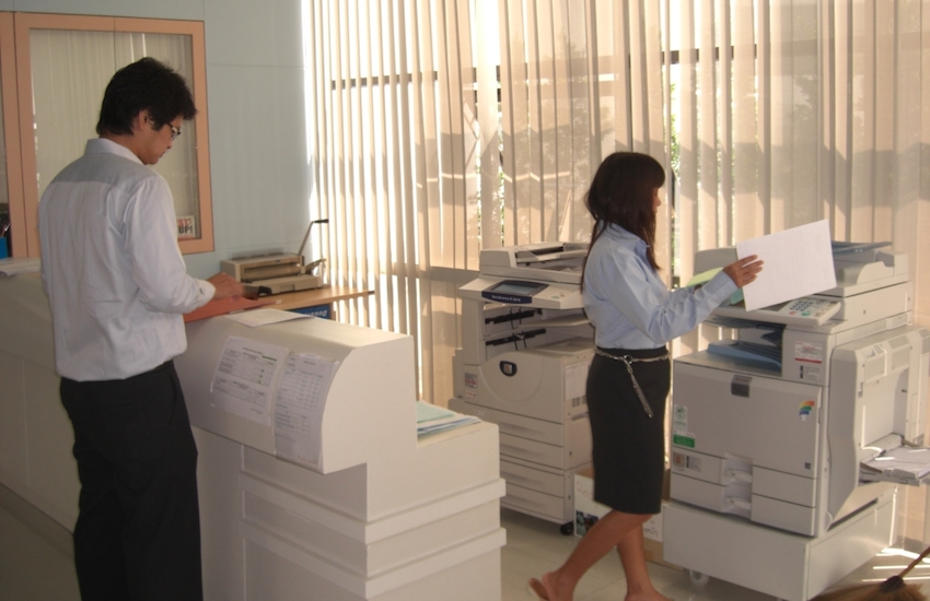 man and woman at photocopier in office