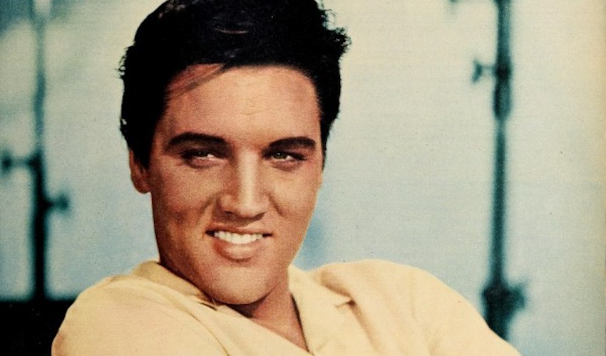 elvis presley posing for photo