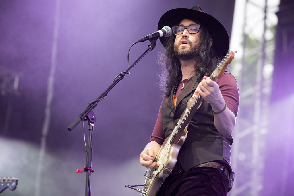 Sean Lennon playing with his band.