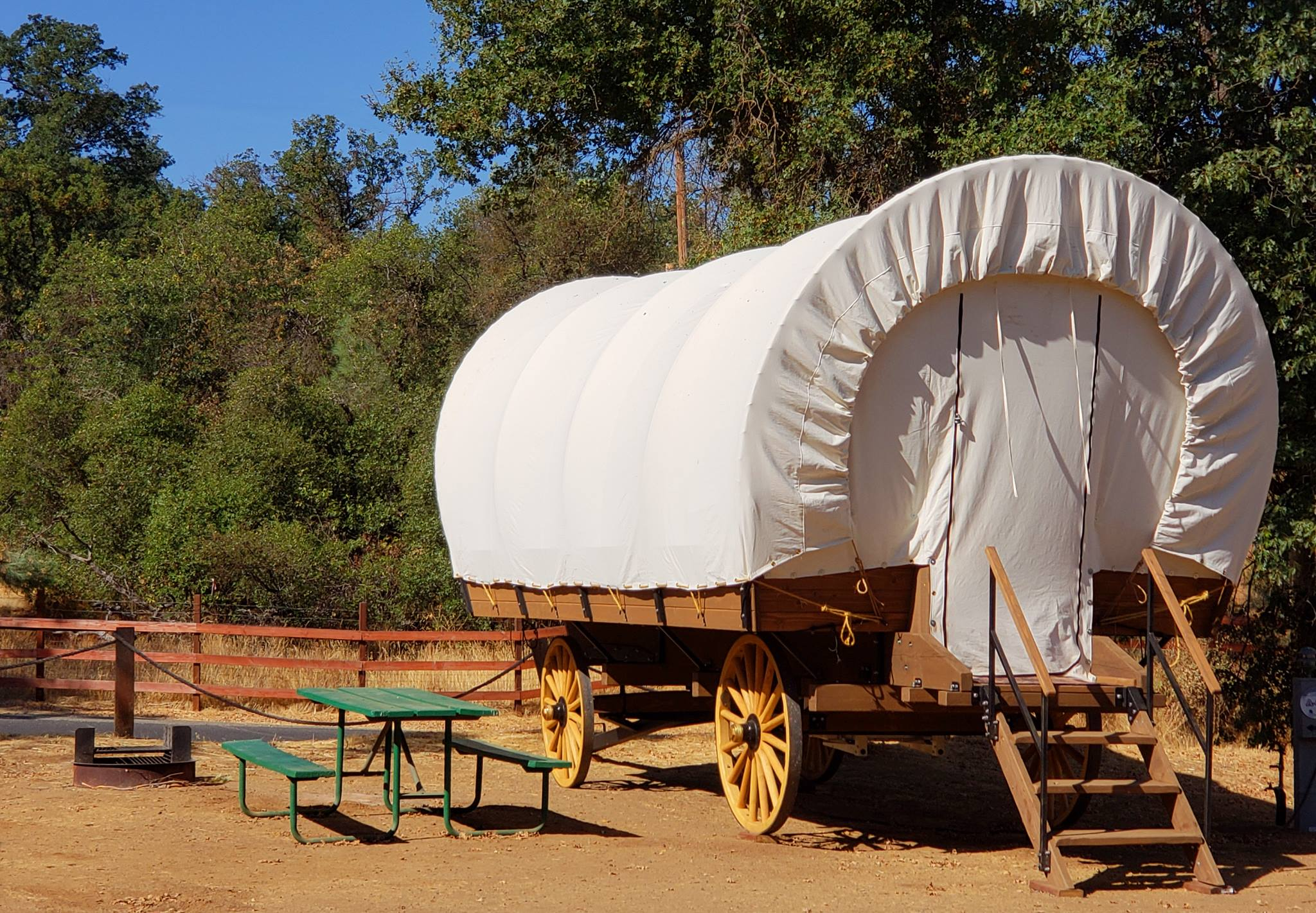 Pretend You Are A Pioneer In Covered Wagon Cabins Near
