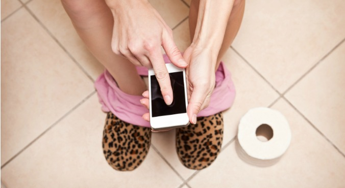 texting on the toilet