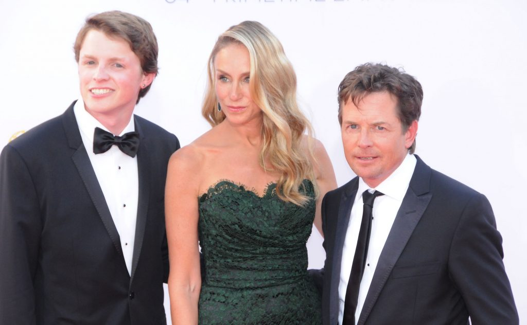 Michael J. Fox with son Sam Fox, and wife Tracy Pollan pose on red carpet at 64th Primetime Emmy Awards
