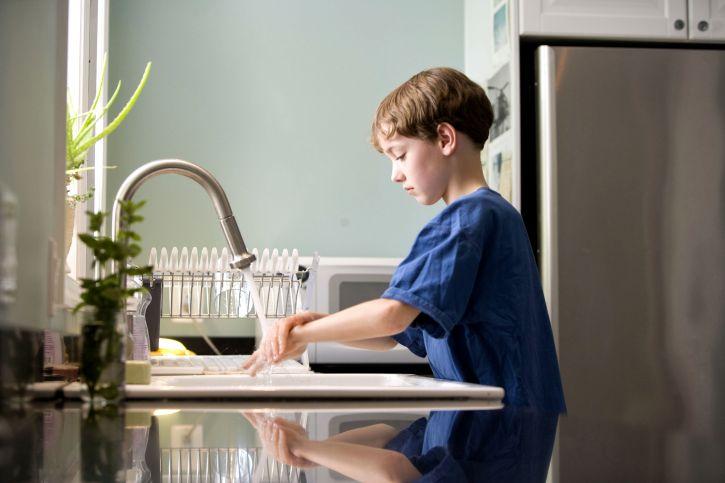 boy washing hands