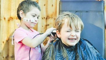 little boy lets best friend shave head