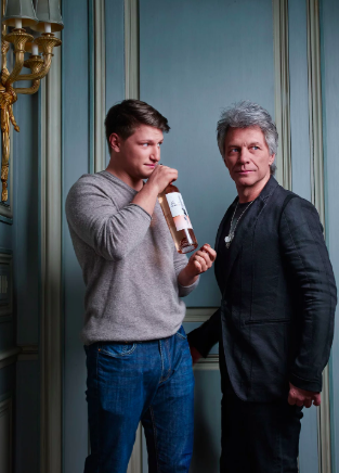 bon jovi and his son with wine