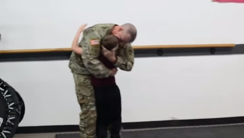 boy spars with deployed dad