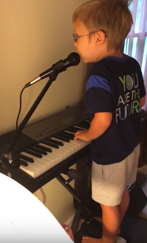 blind boy playing piano