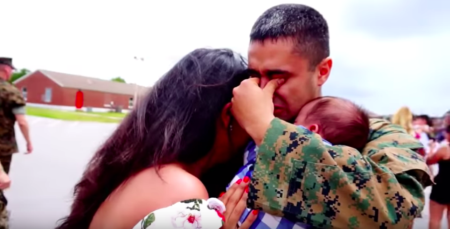 Marine meeting newborn son for the first time