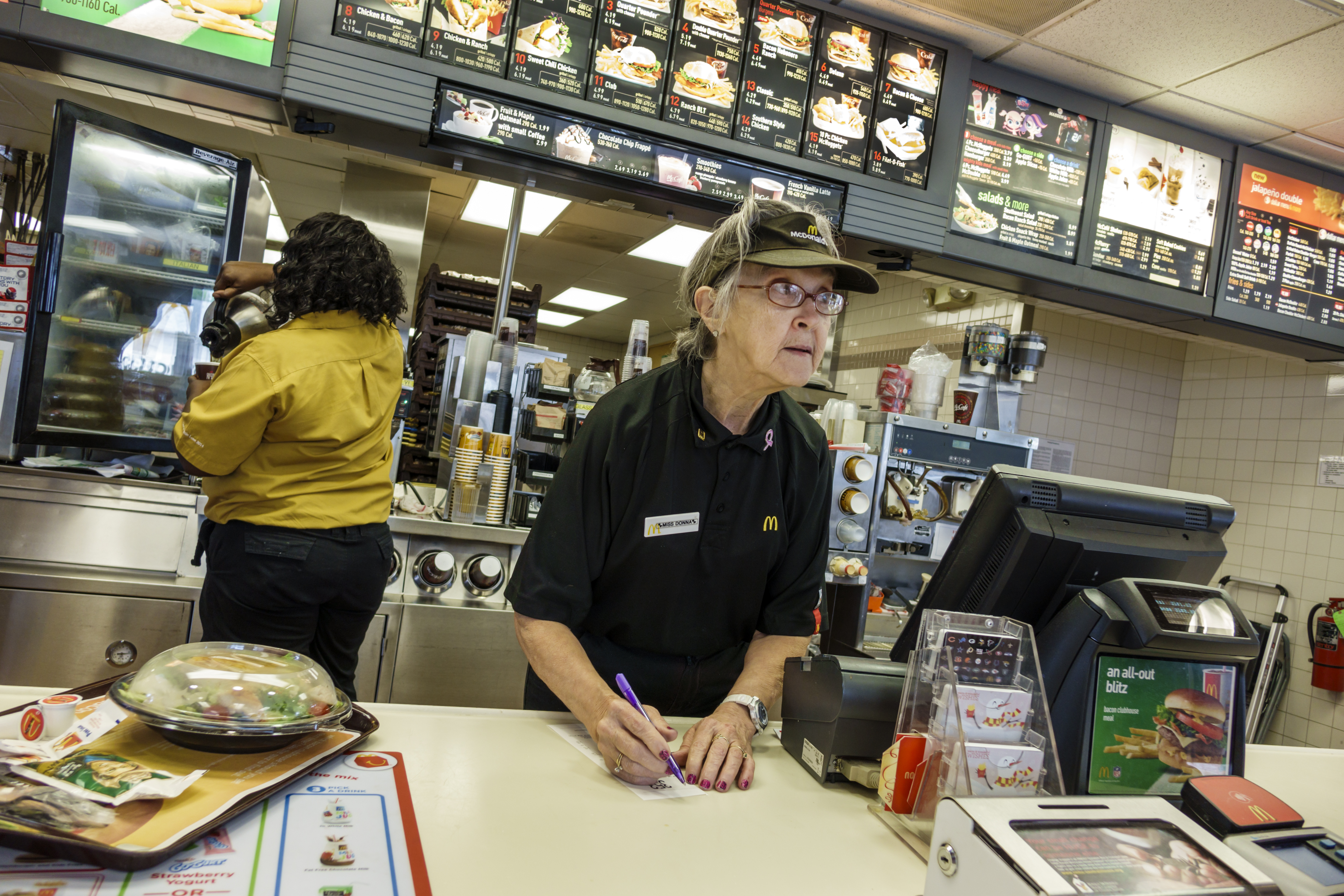 senior woman working at mcdonalds