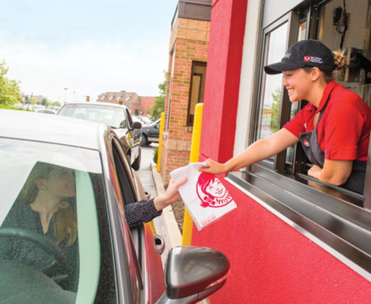 friendly employee at drive-thru