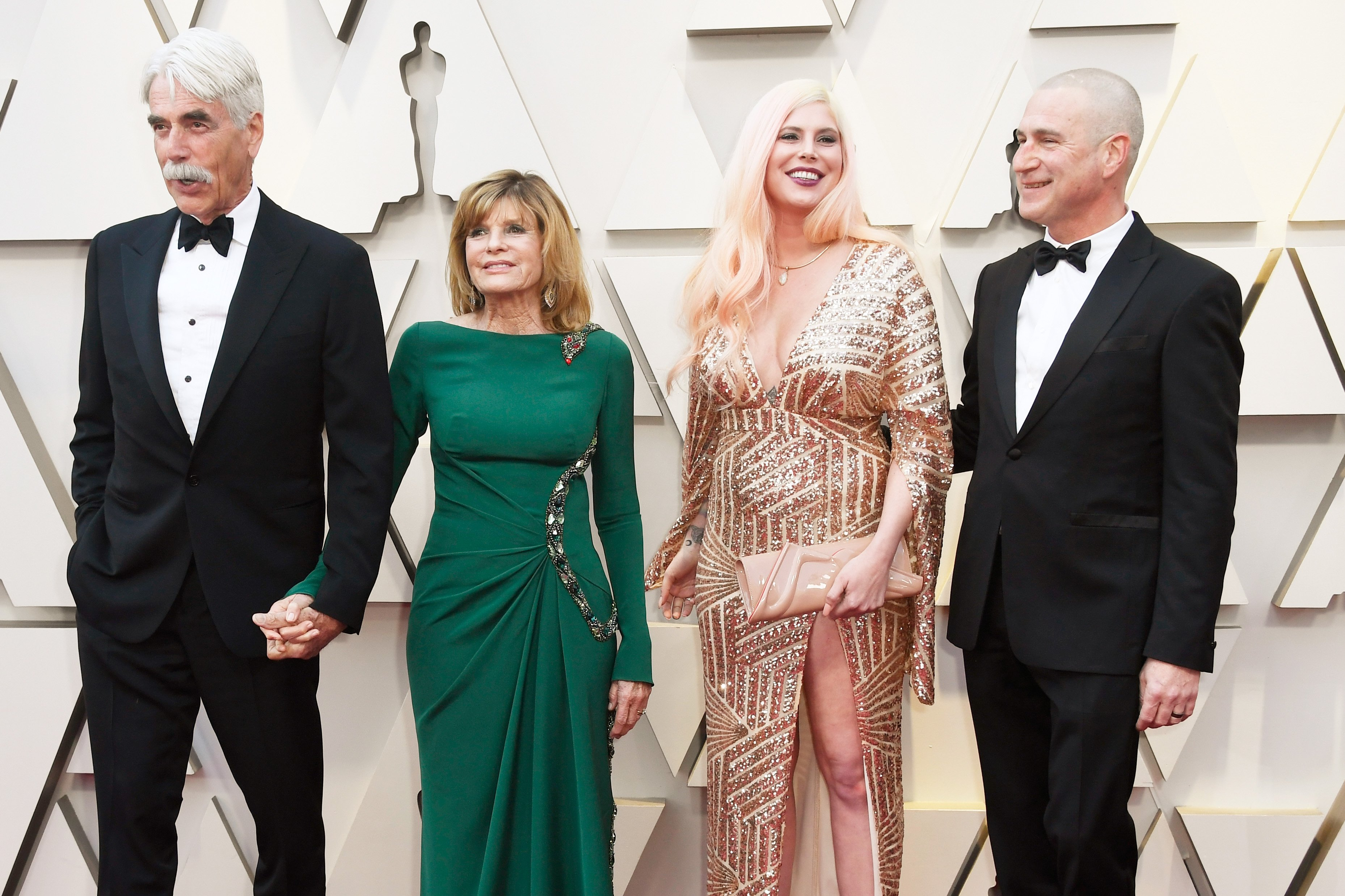 Sam Elliott with wife Katharine Ross and daughter Cleo Rose Elliott posing on red carpet at 91st Annual Academy Awards