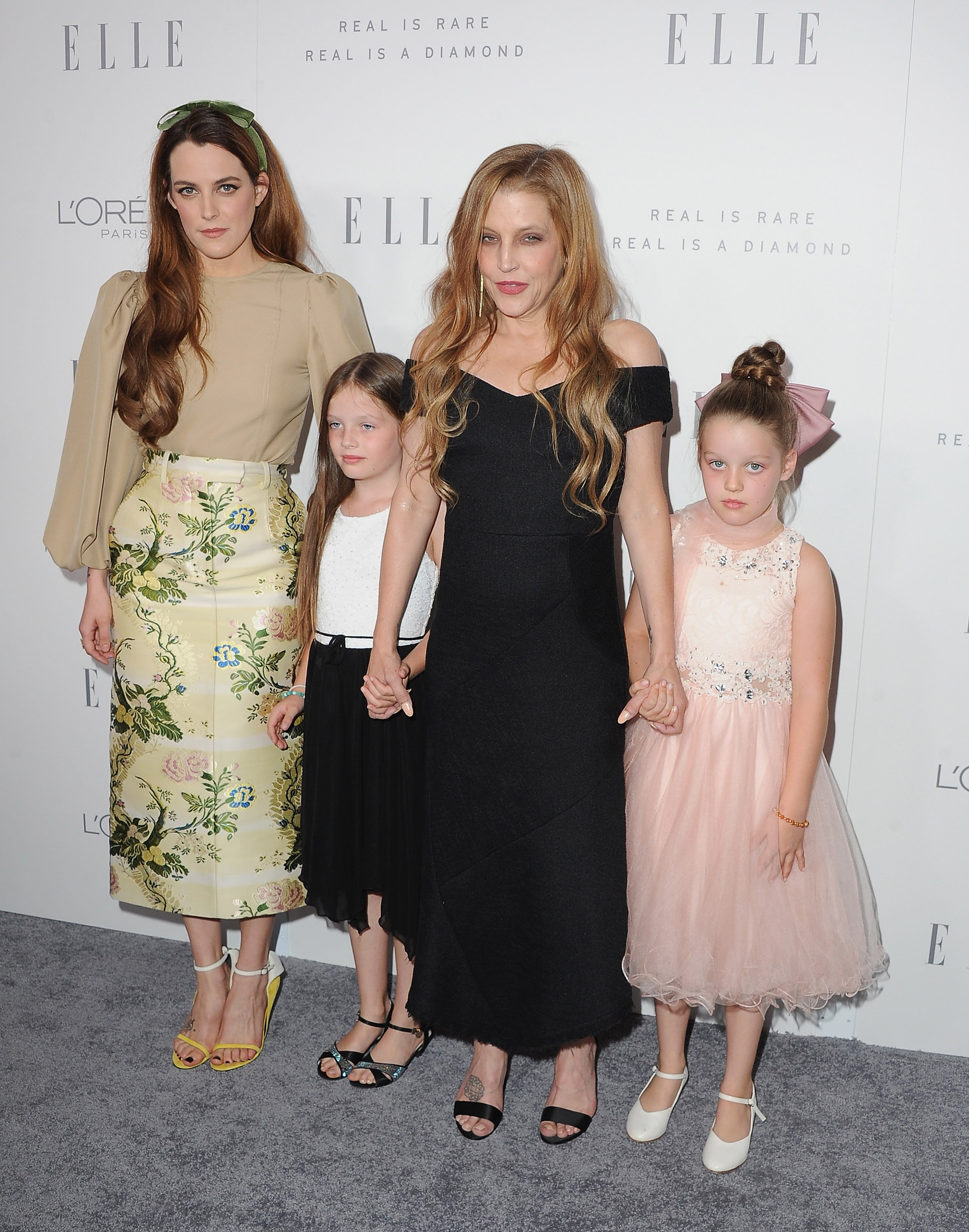 Lisa Marie Presley and daughters Harper Finley and Riley
