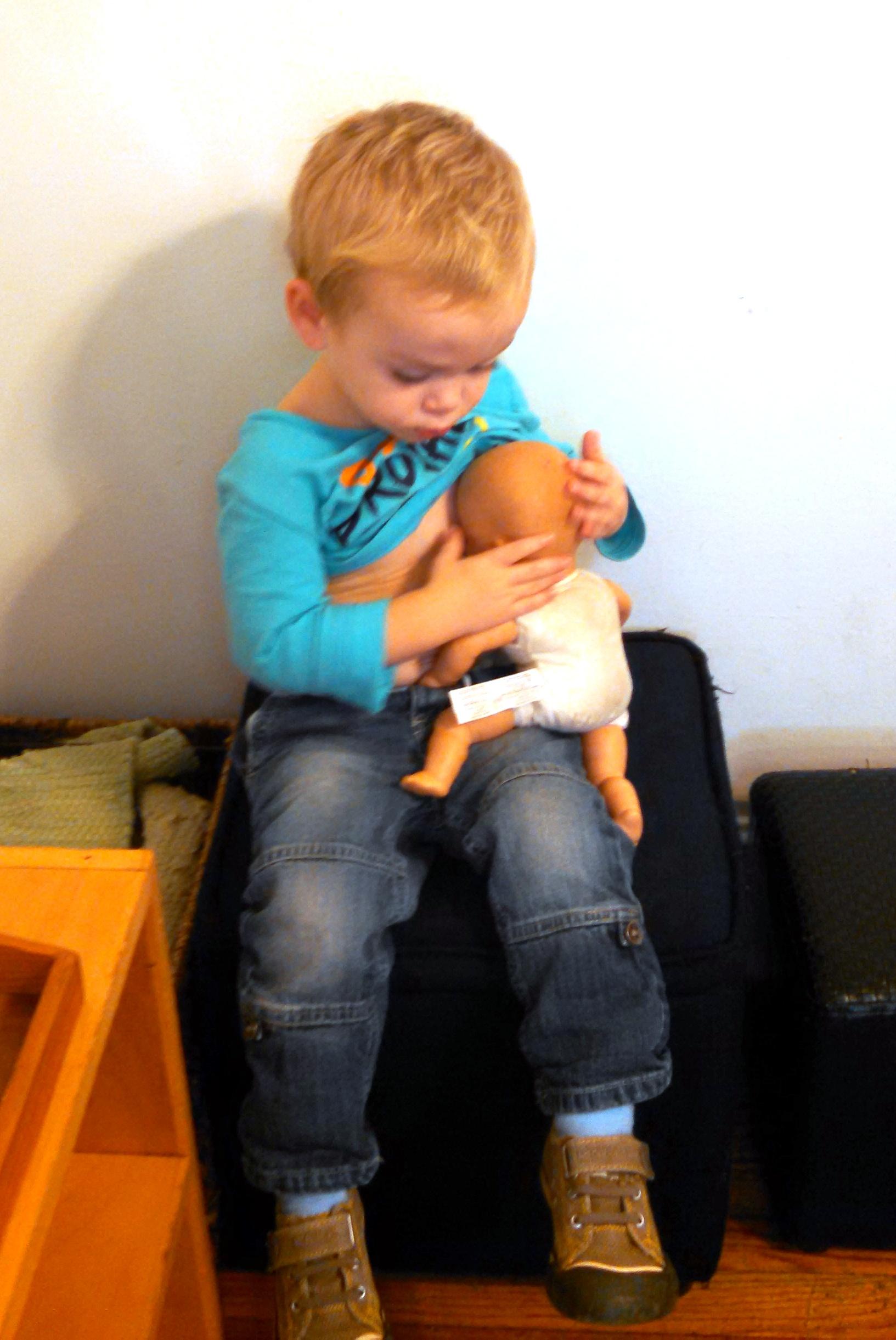 boy with doll