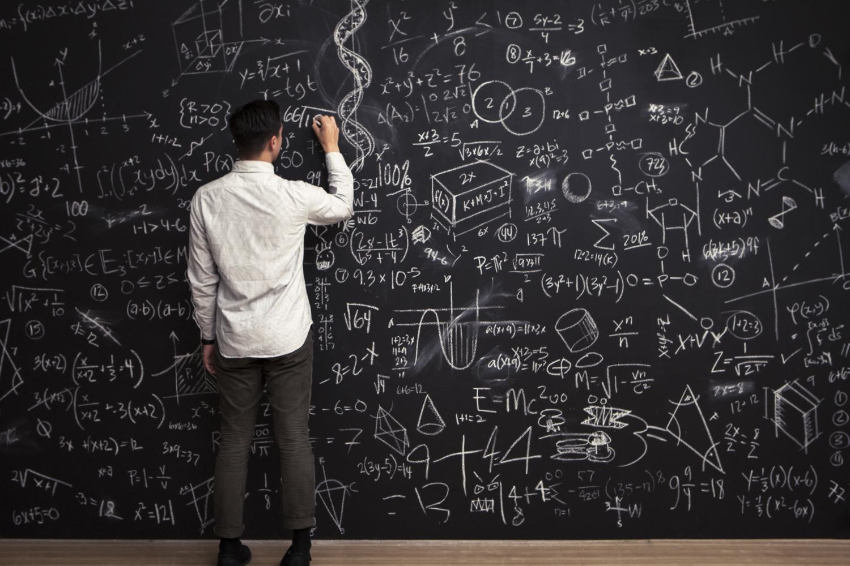 Writing math problems on chalkboard