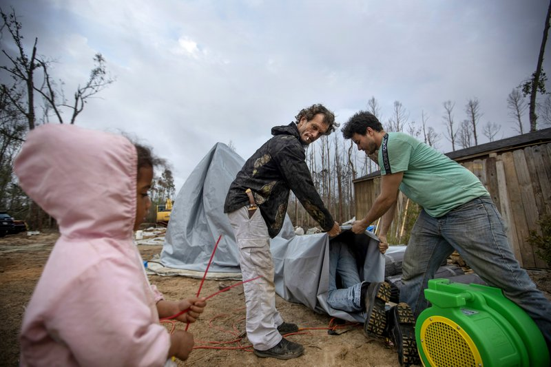 Hurricane Michael victims helping out