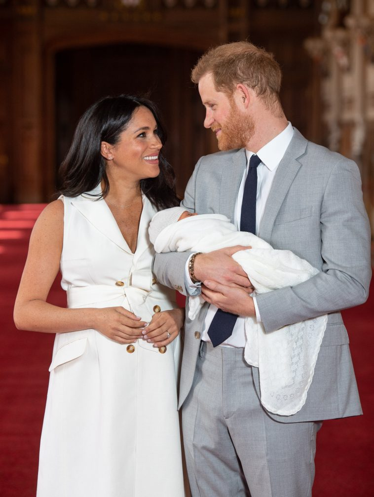 prince harry and meghan markle with new baby