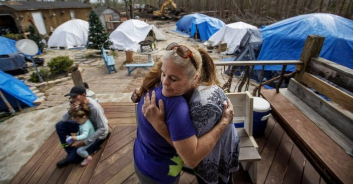 woman helps victims of hurricane michael with tent community