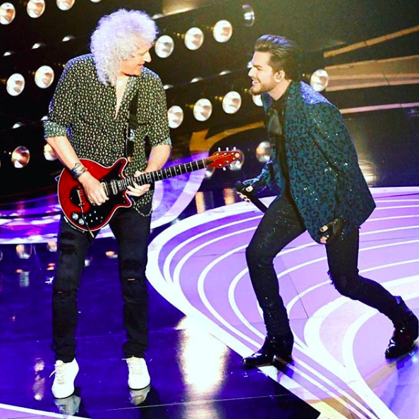 Adam Lambert performing with Queen