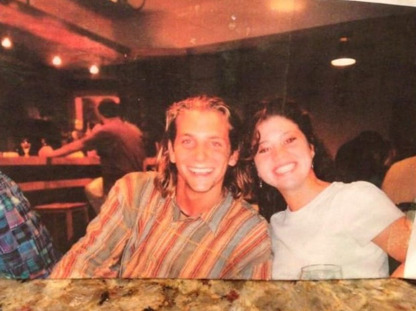 young Bradley Cooper posing with a girl