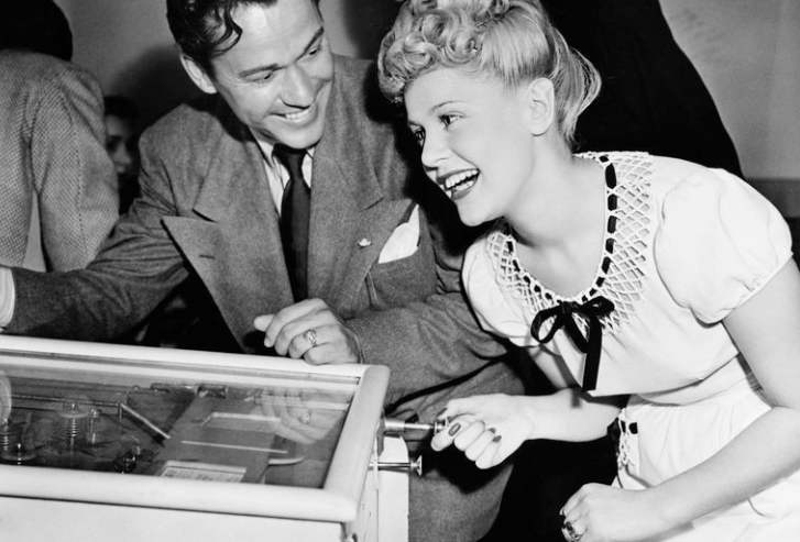 Couple playing Pinball in the 40s/50s