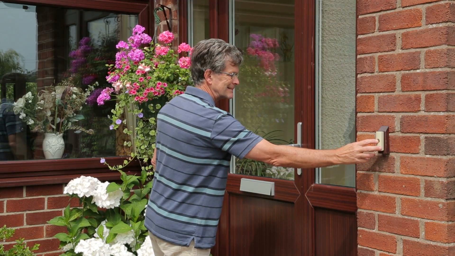 man ringing a doorbell