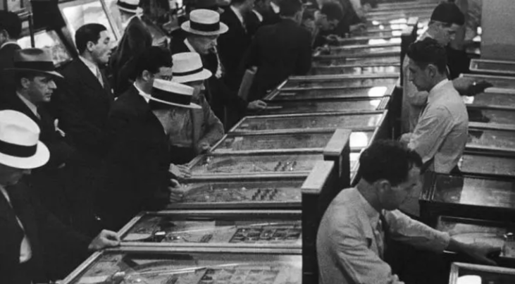 People playing pinball in the 40s
