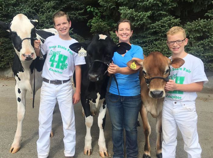 Mitchell's family posing for photo with cows