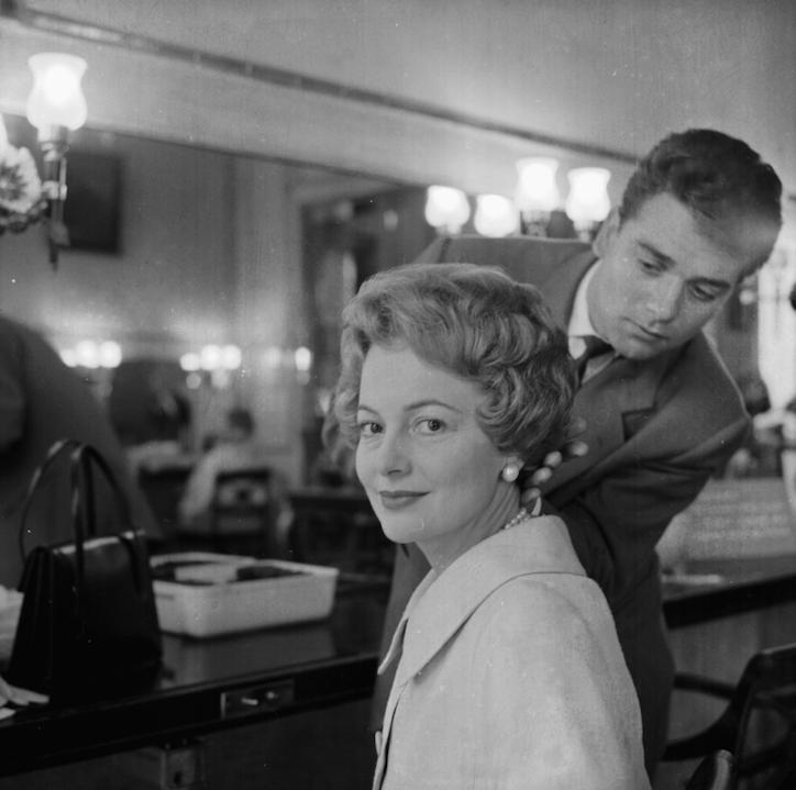 Olivia de Havilland in 1958 getting hair/makeup done