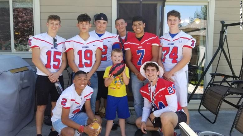 boy with autism celebrates birthday with football team