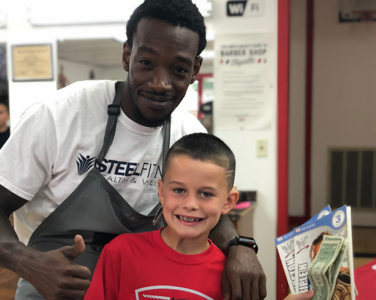barber pays kids who read book during haircuts