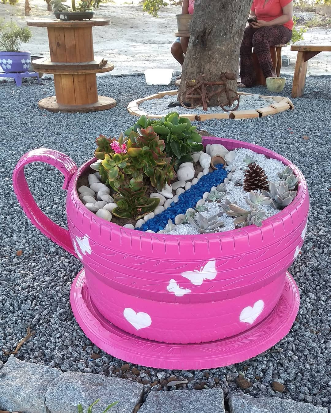 artist repurposes old tires for dog beds and community planters