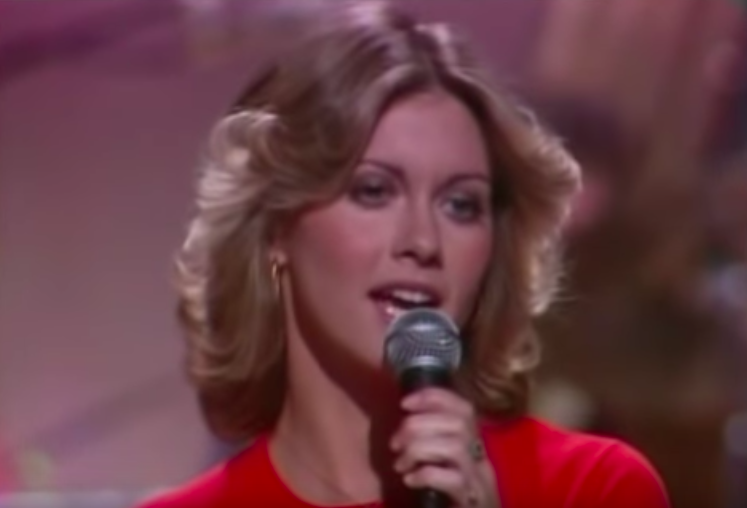 "Olivia Newton-John singing ""Have You Never Been Mellow"""