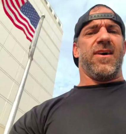 veteran climbs flag pole to fix american flag