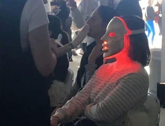 woman wearing a weird mask