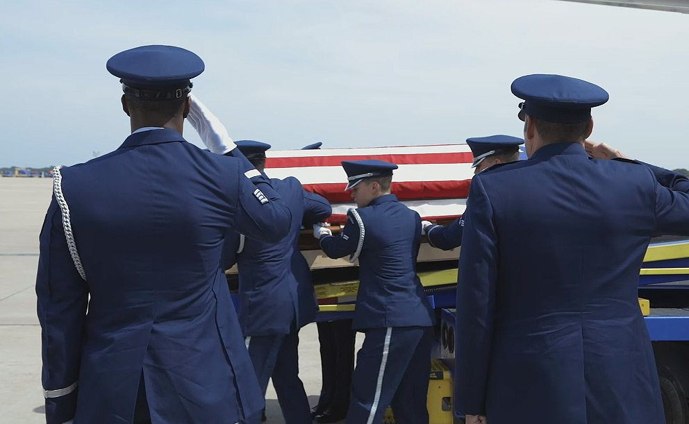 Carrying the late war vet's casket out