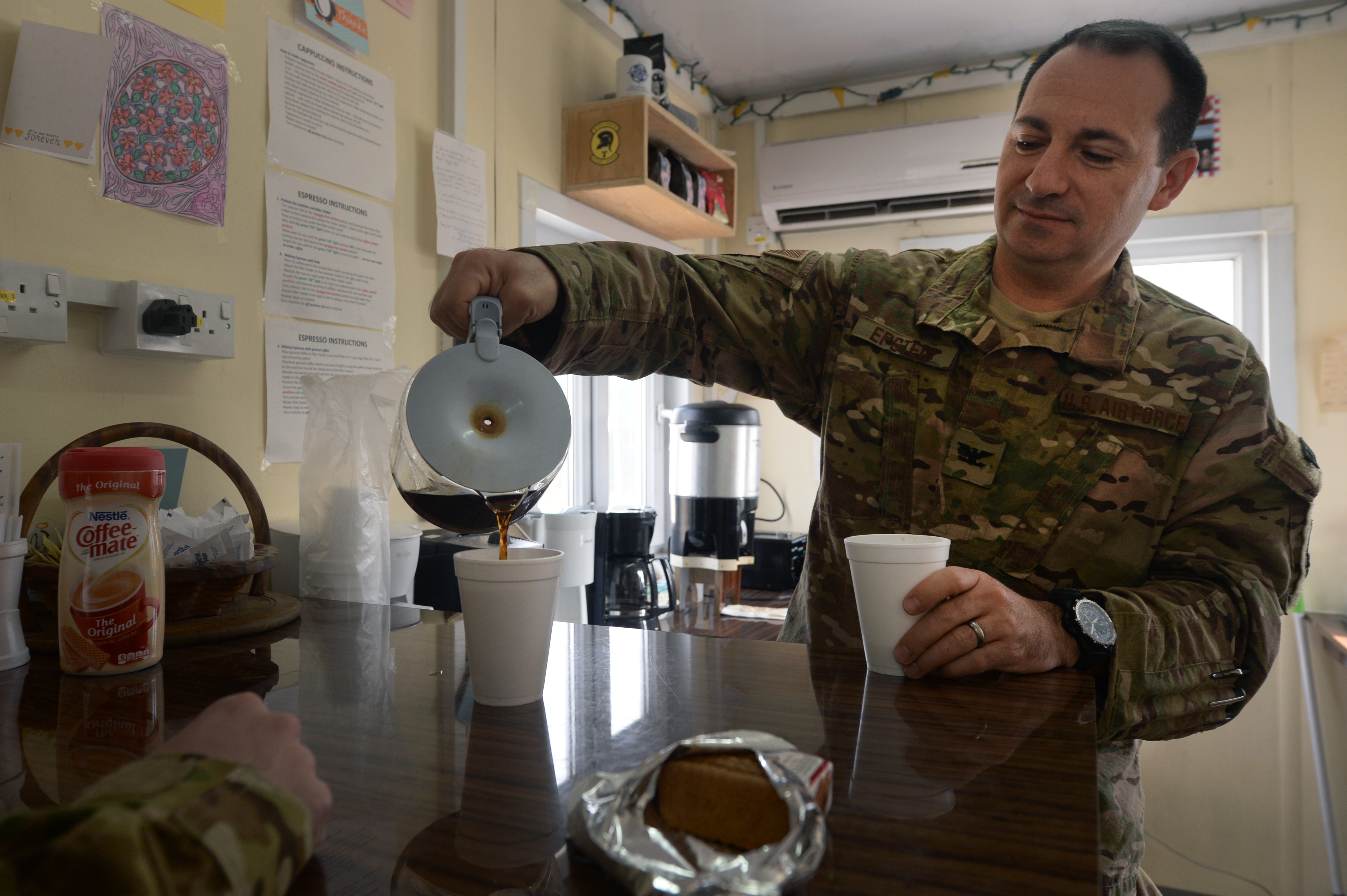 army soldier drinking coffee
