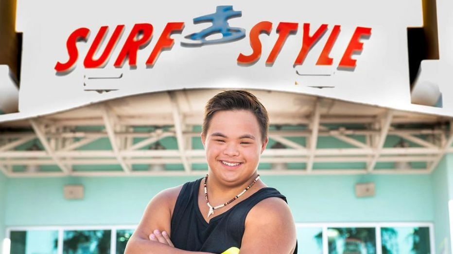 boy with down syndrome face of beachwear company
