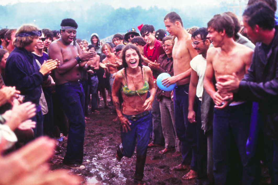 Woman runs through mud at Woodstock