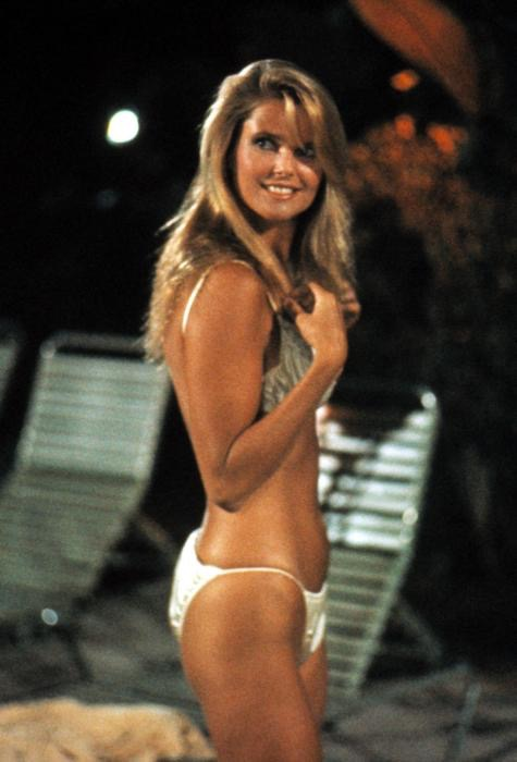 Christie Brinkley smiling by the pool during 'National Lampoon's Vacation'.