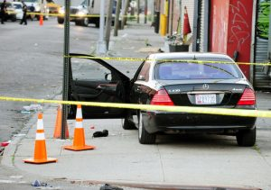 Police investigation of the fatal shooting of a carjacker by retired officer Derrick Bishop