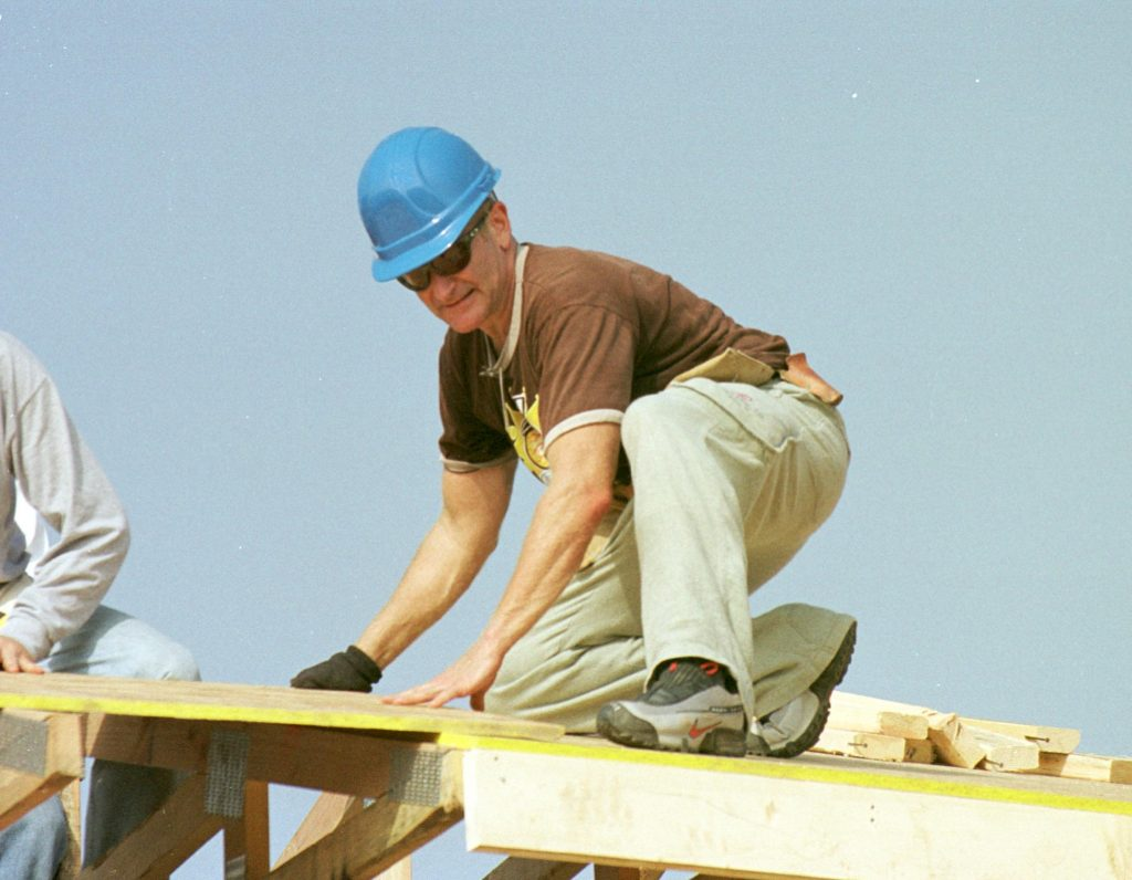 Actor Robin Williams Helps Build Homes