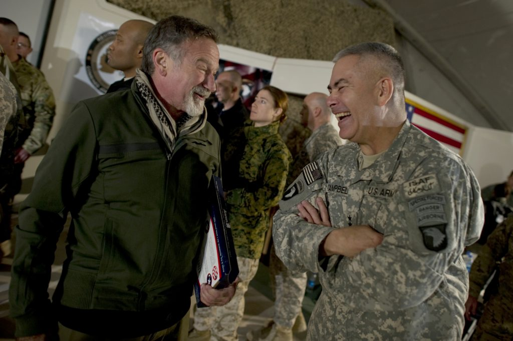 Comedian Robin Williams visits with Commanding General of Combined Task Force 101 U.S. Army Lt. Gen. John F. Campbell after the USO Holiday Tour show at Bagram Air Field, Afghanistan.