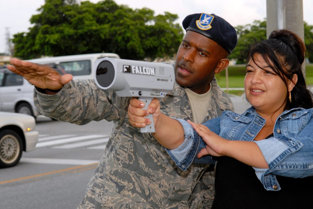 Tech. Sgt. Ronald Keeve instructs Army spouse Vanessa Chavez on the use of a speed detecting radar gun during the civilian police academy course May 27 at Kadena Air Base, Japan. Sergeant Keeve is a member of the 18th Security Forces Squadron.