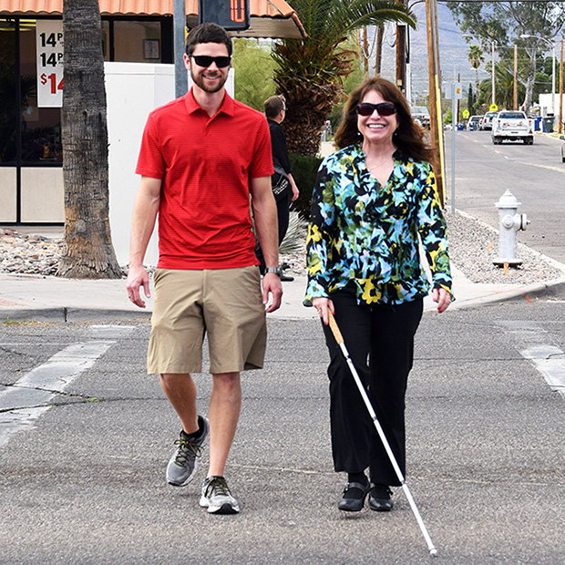 blind person walks with cane