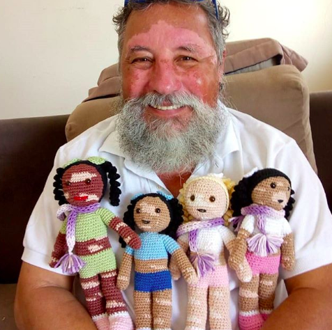 grandfather knits dolls for kids with vitiligo