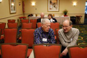 Francis Currey (L) speaking with Holocaust survivor Micah Tomkiewicz (R) at a 30th Infantry Division reunion in 2010